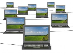 Conceptual image of a network from laptops. 3D illustrations.
